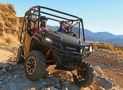2017.honda_.pioneer1000-5deluxe.front_.grey_.riding.over-rocks.jpg