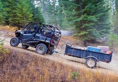2017.honda_.pioneer1000-5deluxe.left_.grey_.hauling-trailer.on-trail.jpg