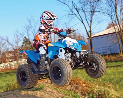 2017.polaris.outlaw110.front-right.blue_.jumping.in-air.jpg