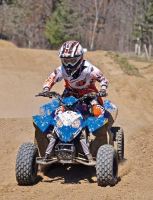 2017.polaris.outlaw110.front_.blue_.riding.on-dirt.jpg