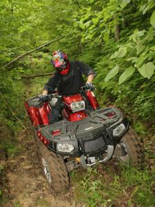 2011.polaris.sportsman-xp850.red_.front_.riding.on-trail.jpg