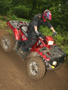 2011.polaris.sportsman-xp850.red_.right_.riding.on-dirt.jpg