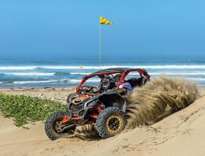 2017.can-am.maverick-x3.front-left.riding.on-sand.jpg