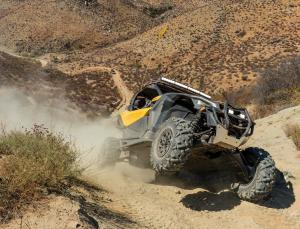 2017.can-am.maverick-x3.front-right.riding.up-hill.jpg