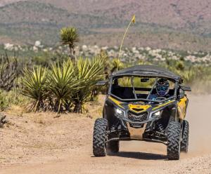 2017.can-am.maverick-x3.front.yellow.riding.on-sand.jpg