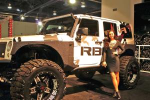 feature.2016.sema-expo.lifted-jeep-and-model.jpg