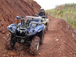 location.2016.iron-range-trail-system-minnesota.atv-parked-on-dirt.jpg