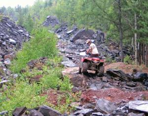 location.2016.iron-range-trail-system-minnesota.atv-riding-over-rocks.jpg