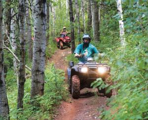 location.2016.iron-range-trail-system-minnesota.atv-riding-through-woods.jpg