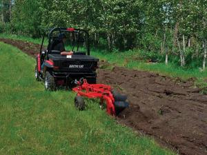 vendor.2012.quadivator-plow.preparing-field.rear_.pulling-behind.utv_.jpg
