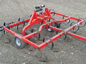 vendor.2012.quadivator-spring-tine-cultivator.parked.on-dirt.jpg