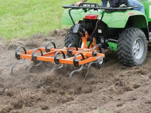 vendor.2012.quadivator-spring-tine-cultivator.preparing-field.rear_.pulling-behind.atv_.jpg
