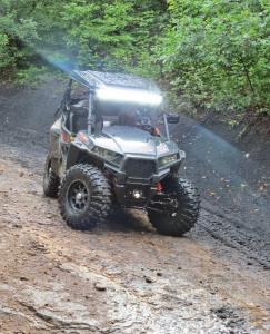 vendor.quadboss.446-radial-tire.on-polaris-rzr.riding-on-path.jpg
